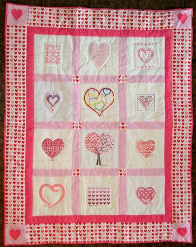 Photo of (QUILTED) Heartss quilt