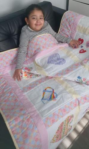 Photo of Amana Js quilt