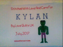 Cross stitch square for Kylan J's quilt