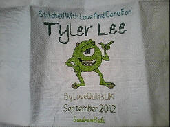 Cross stitch square for Tyler Lee's quilt
